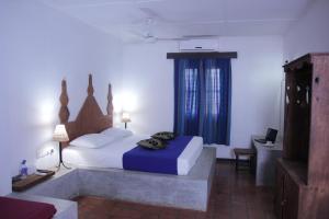 Postel nebo postele na pokoji v ubytování Dambulu Oya Family Park