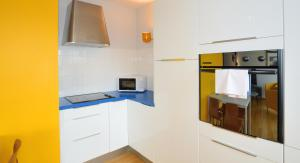 A kitchen or kitchenette at Appart' Parc