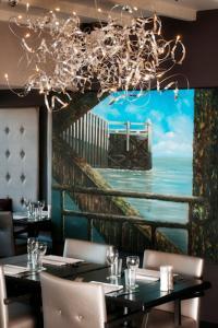 Restaurant ou autre lieu de restauration dans l'établissement De Mangerie Guesthouse Promenade