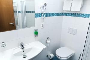 Ванна кімната в ABE Hotel