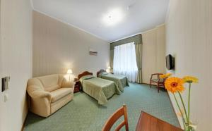 Гостиная зона в Отель 9 Сов