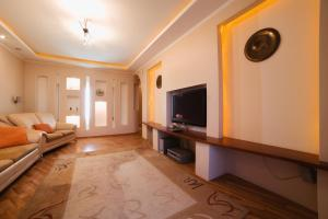 A television and/or entertainment center at Five Stars on Lenina 68a