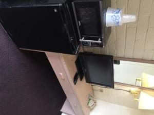A television and/or entertainment center at Budget Inn Safford