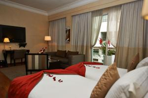 A bed or beds in a room at Park Suites Hotel & Spa