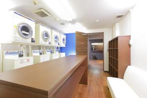 A kitchen or kitchenette at HOTEL MYSTAYS Otemae