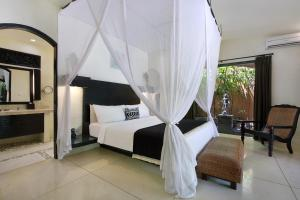 A bed or beds in a room at Impiana Private Villas Seminyak