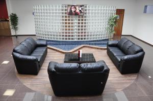 Uma área de estar em Hotel Bela Vista Votorantim