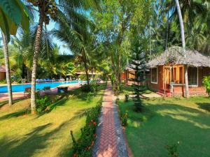 A garden outside Abad Harmonia Ayurvedic Beach Resort