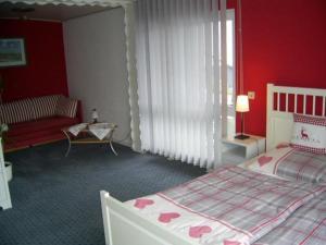 Ein Bett oder Betten in einem Zimmer der Unterkunft Ferienwohnung Veronika Pape