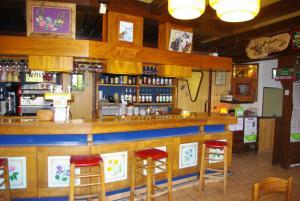 Salon ou bar de l'établissement Hotel le Tourisme