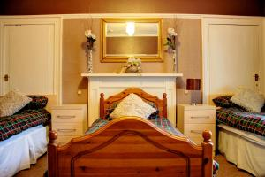 A bed or beds in a room at Atticus Central Guest House