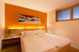 Ein Bett oder Betten in einem Zimmer der Unterkunft Alpenappartement Bergkönig