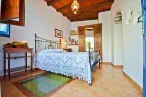 Ένα ή περισσότερα κρεβάτια σε δωμάτιο στο Venetiko Apartments