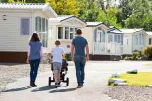 A family staying at Lomond Woods Holiday Park