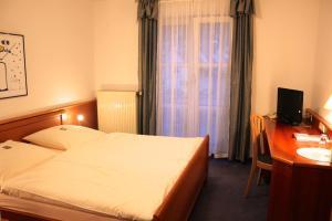 Ein Bett oder Betten in einem Zimmer der Unterkunft Hotel Gasthaus Bock