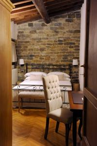 A bed or beds in a room at ARIA DI CASA APARTMENT