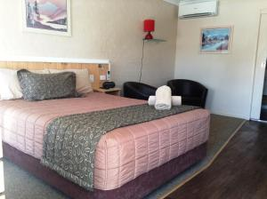 A bed or beds in a room at Winchester Motel