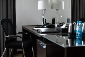 A kitchen or kitchenette at Solutel Hotel