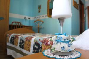Ein Bett oder Betten in einem Zimmer der Unterkunft Hotel La Fontana