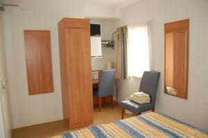 A bed or beds in a room at De Willigen Logies