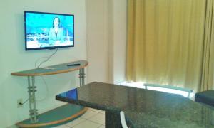 A television and/or entertainment center at Apartamento Eldorado Thermas Park
