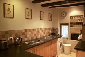 A kitchen or kitchenette at Sarlat Town House
