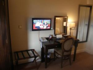 A television and/or entertainment center at Baileys Hotel Cashel