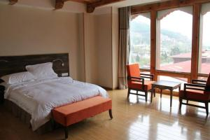 A bed or beds in a room at Hotel Thimphu Tower