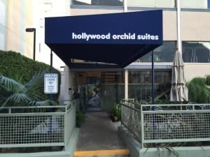 The facade or entrance of Hollywood Orchid Suites