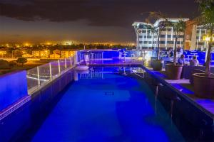 The swimming pool at or near Protea Hotel by Marriott Gaborone Masa Square