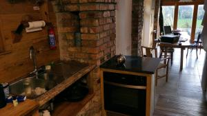 A kitchen or kitchenette at Ronan's Cottage