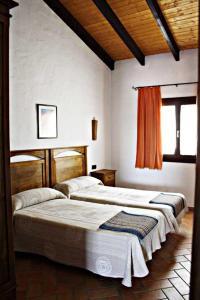 Cama o camas de una habitación en Casa Rural Elanio Azul