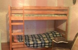 A bunk bed or bunk beds in a room at Flat Yugo-Zapad