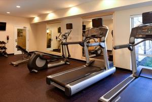 The fitness center and/or fitness facilities at TownePlace Suites by Marriott Detroit Commerce
