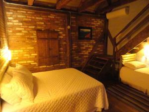 A bed or beds in a room at Hospedaria Rio do Vento