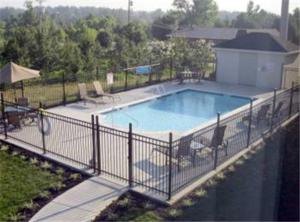 The swimming pool at or near Baymont by Wyndham Madisonville