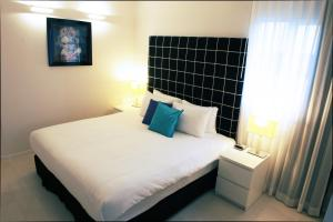 A bed or beds in a room at Best Western Regency Suites