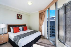 A bed or beds in a room at Mantra on Mary