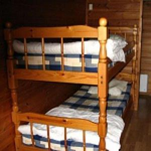 A bunk bed or bunk beds in a room at Mullsjö Camping
