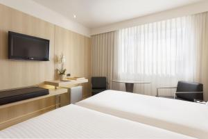 A bed or beds in a room at AC Hotel Cordoba
