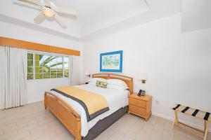 A bed or beds in a room at All-Inclusive - Wyndham Reef Resort Grand Cayman