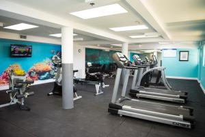 The fitness center and/or fitness facilities at All-Inclusive - Wyndham Reef Resort Grand Cayman