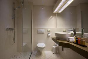 Een badkamer bij Hotel Arrows