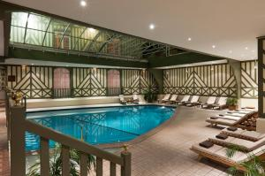 The swimming pool at or near Hôtel Barrière Le Normandy
