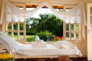 Una cama o camas en una habitación de Iguazú Grand Resort Spa & Casino