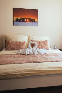Postel nebo postele na pokoji v ubytování Apartmany Fonte