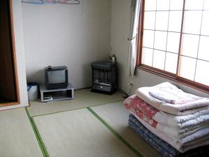 A television and/or entertainment center at Sapporo Inn Nada