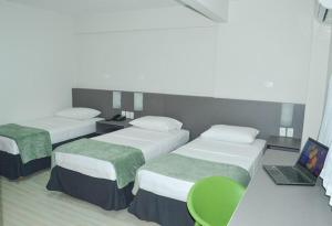 A bed or beds in a room at Pajuçara Hotel Express