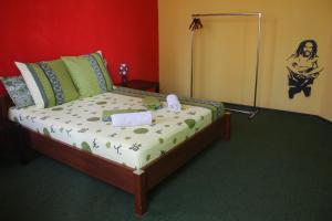 A bed or beds in a room at Magic Bus Kiev Hostel