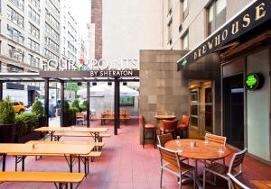 A restaurant or other place to eat at Four Points by Sheraton Manhattan Chelsea